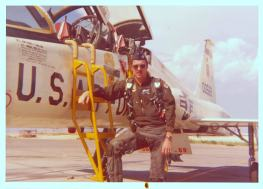 Cliff Young, Associate Dean of Faculty at the University of Colorado Denver Business School, is photographed in front of a T-38.
