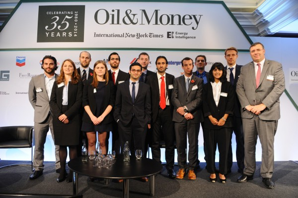 Total CEO Patrick Pouyanne  (right) and the Leaders for Tomorrow Delegates, appear on stage during the INYT/Energy Intelligence Oil & Money Conference - Day 2 on October 30, 2014 in London, England.  (Photo by Anthony Harvey/Getty Images for The New York Times)
